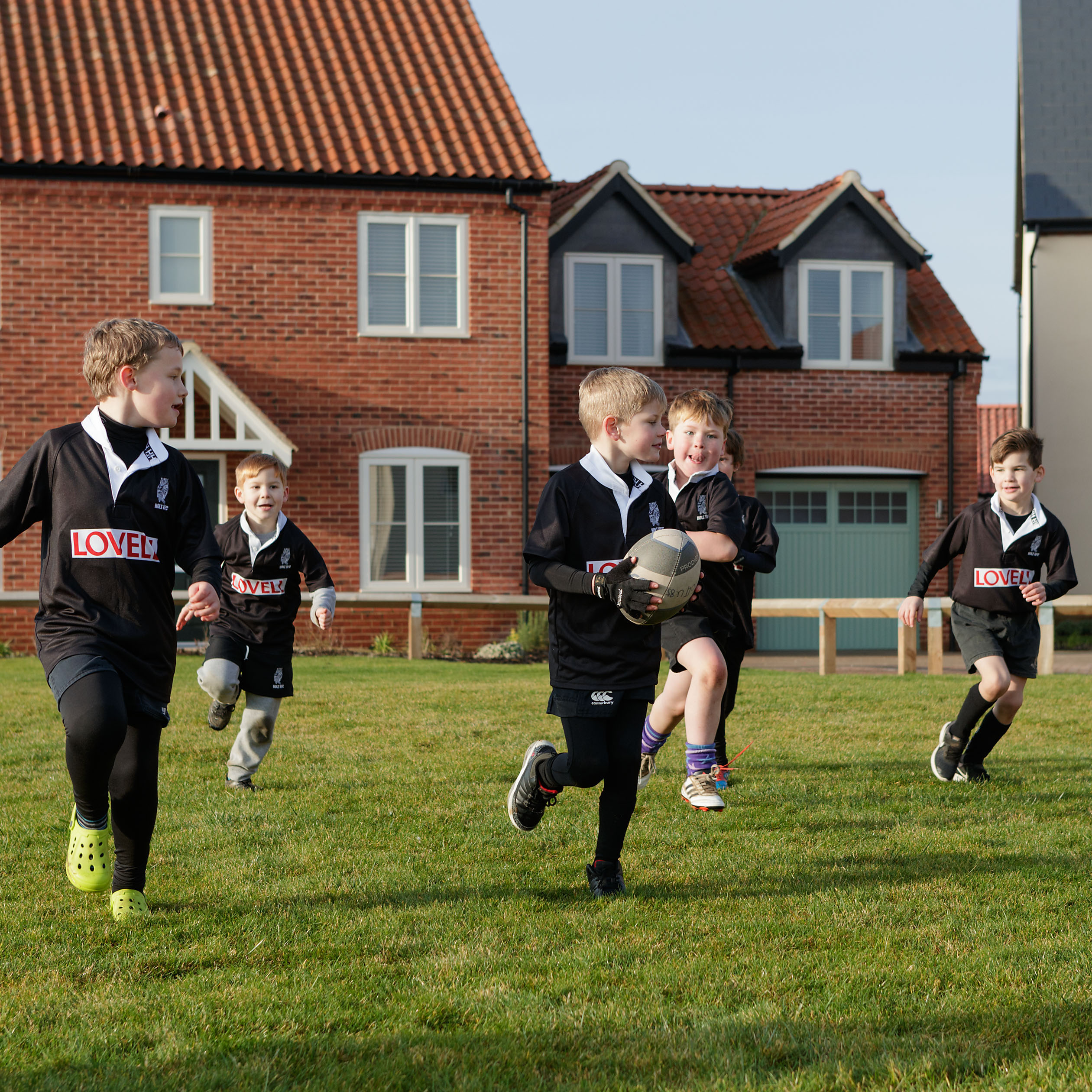 26012031 - Holt RFC 'Mini Rugby' players at Lovell Homes' Heath Farm development in Holt
